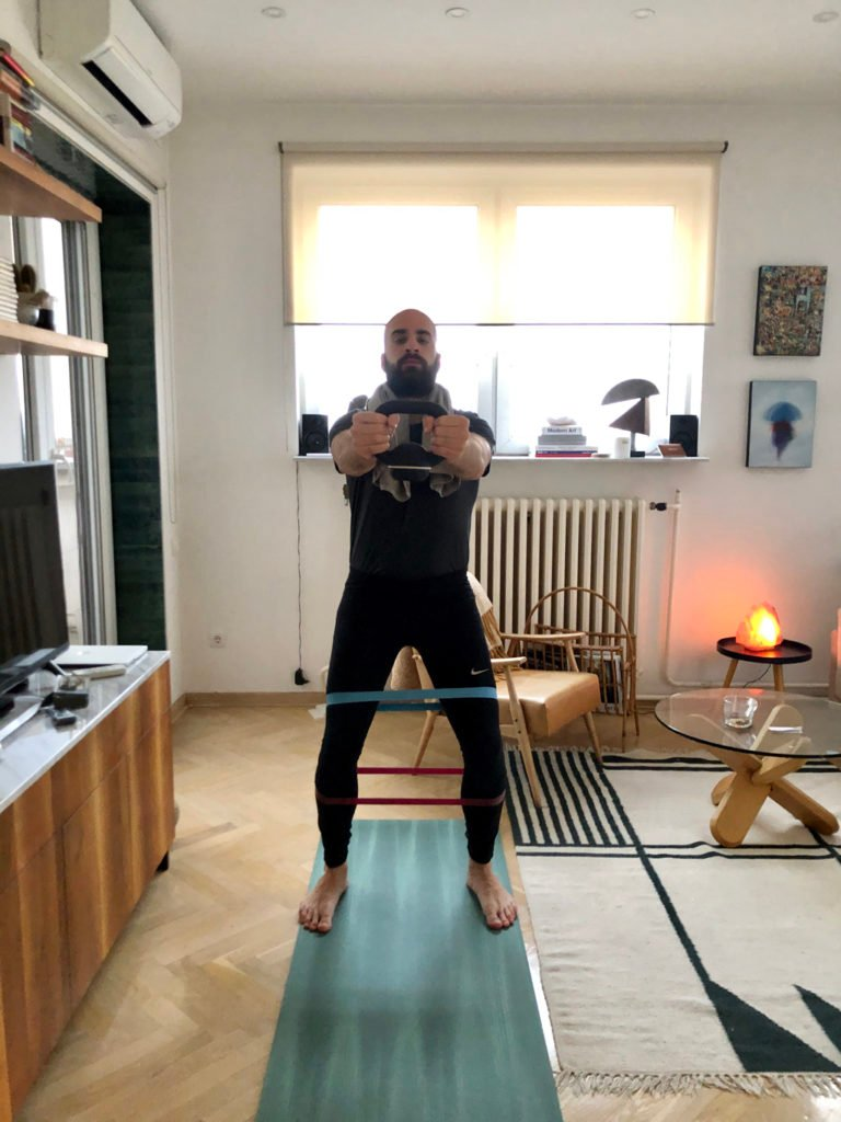 An image of a man working out in an apartment